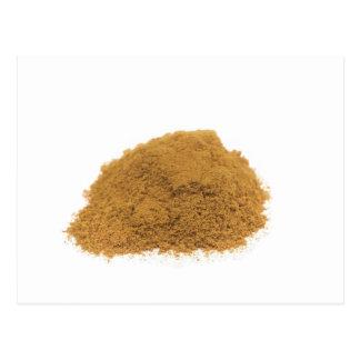Heap of cinnamon powder on white background postcard