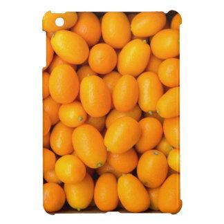 Heap of orange kumquats in cardboard box iPad mini cover