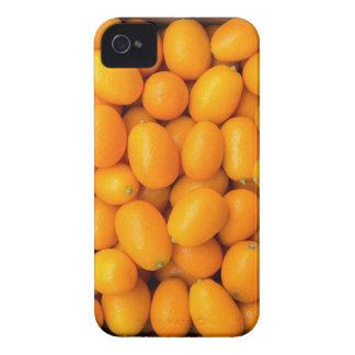 Heap of orange kumquats in cardboard box iPhone 4 cover