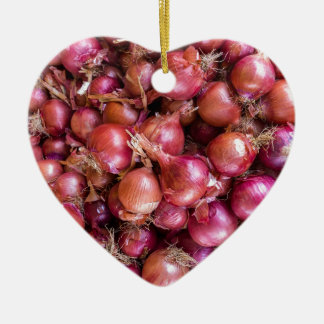 Heap of red onions on market ceramic heart ornament