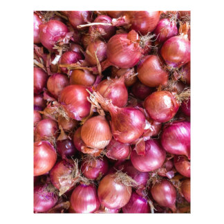 Heap of red onions on market customized letterhead