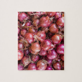 Heap of red onions on market jigsaw puzzle