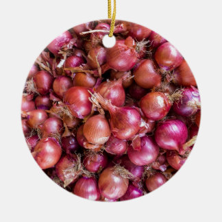 Heap of red onions on market round ceramic ornament