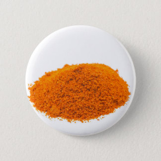 Heap of spice cayenne pepper powder on white 2 inch round button