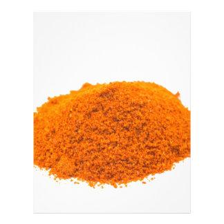 Heap of spice cayenne pepper powder on white letterhead