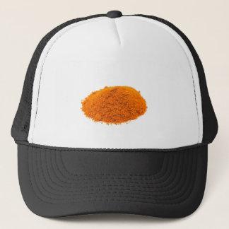 Heap of spice cayenne pepper powder on white trucker hat
