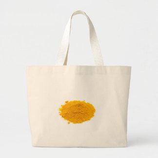 Heap of spice turmeric powder on white background. large tote bag