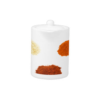 Heaps of several seasoning spices on white