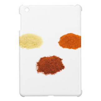 Heaps of several seasoning spices on white iPad mini cover