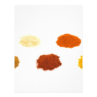 Heaps of several seasoning spices on white letterhead