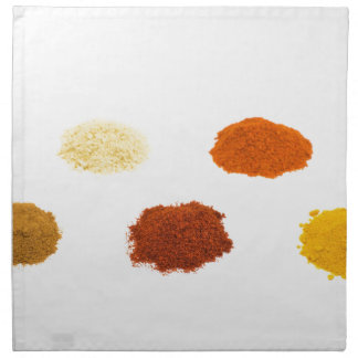 Heaps of several seasoning spices on white napkin