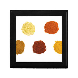 Heaps of various seasoning spices on white gift box
