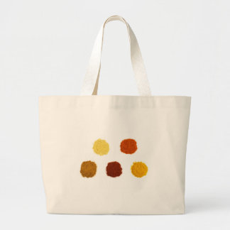 Heaps of various seasoning spices on white large tote bag
