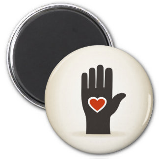 Heart in a hand 2 inch round magnet