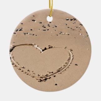 heart in sand round ceramic ornament