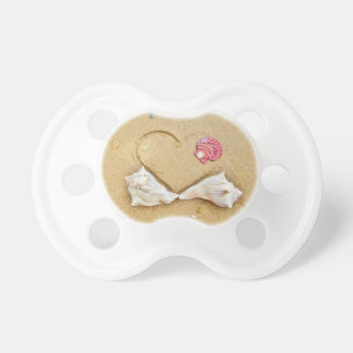 heart in the sand with shells baby pacifier