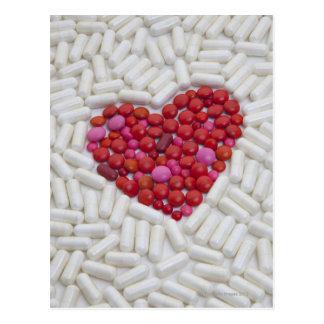 Heart made of red pills postcard