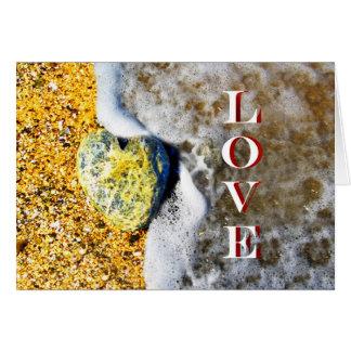 Heart shaped Love Pebble on the Beach Card
