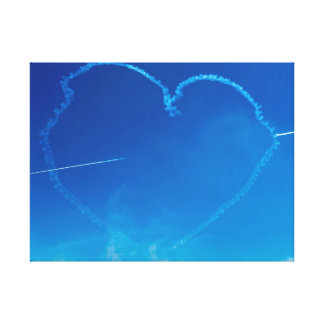 Heart-shaped plane trails canvas print