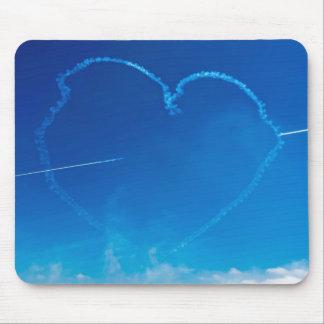Heart-shaped plane trails mousepad