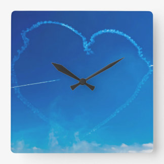 Heart-shaped plane trails square wall clock