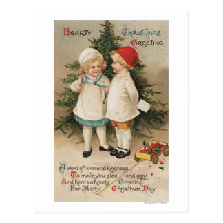 Hearty Christmas GreetingKids by a Tree Postcard