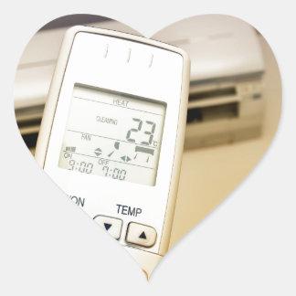 Heat or cool heart sticker