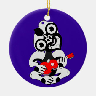 Hei Tiki playing ukelele Round Ceramic Ornament