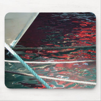 Helmet of fishing boat and reflections in the mouse pad