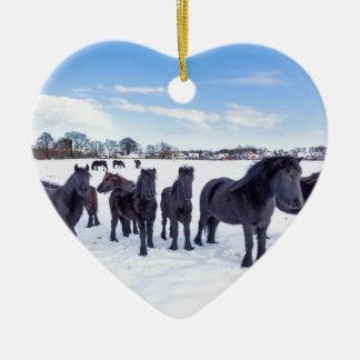 Herd of black frisian horses in winter snow ceramic heart ornament