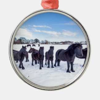 Herd of black frisian horses in winter snow Silver-Colored round ornament