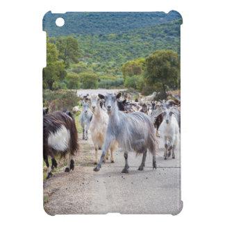 Herd of mountain goats walking on road iPad mini cases