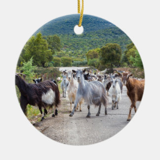 Herd of mountain goats walking on road round ceramic ornament