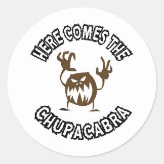 Here comes the chupacabra round sticker