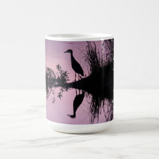 Heron (and reflection) at sunset, with quote coffee mug