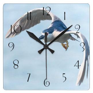 Heron in flight square wall clock