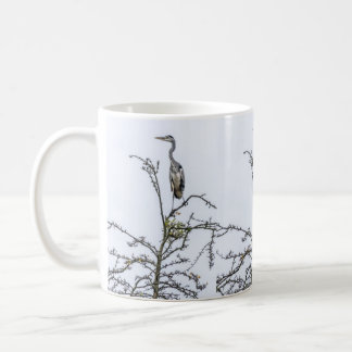 Heron on a tree coffee mug