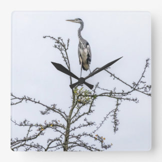 Heron on a tree square wall clock