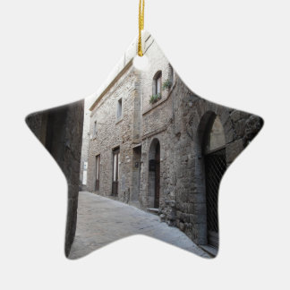 Hidden alley in Volterra village, province of Pisa Ceramic Star Ornament