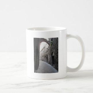 Hidden alley in Volterra village, province of Pisa Coffee Mug