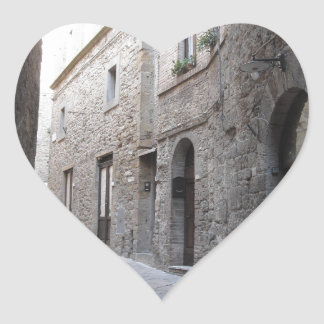 Hidden alley in Volterra village, province of Pisa Heart Sticker