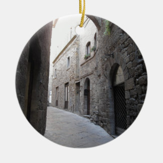 Hidden alley in Volterra village, province of Pisa Round Ceramic Ornament