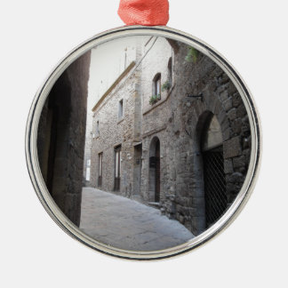 Hidden alley in Volterra village, province of Pisa Silver-Colored Round Ornament