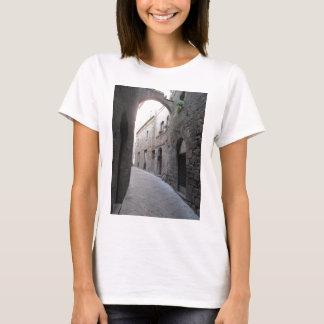 Hidden alley in Volterra village, province of Pisa T-Shirt