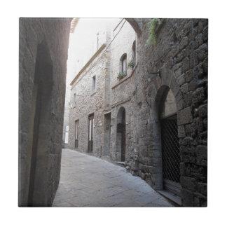 Hidden alley in Volterra village, province of Pisa Tile