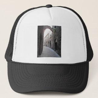 Hidden alley in Volterra village, province of Pisa Trucker Hat