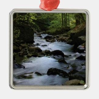 hidden stream in forest metal ornament