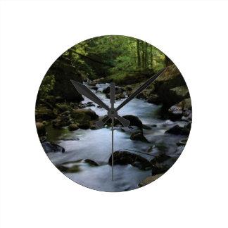 hidden stream in forest round clock