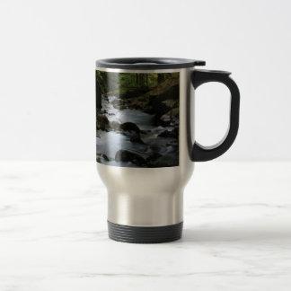 hidden stream in forest travel mug