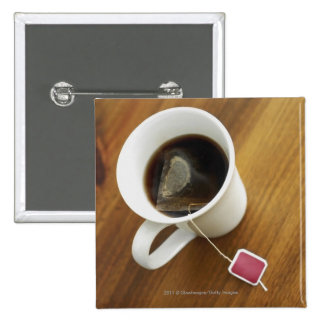 High angle view of a cup of tea 2 inch square button